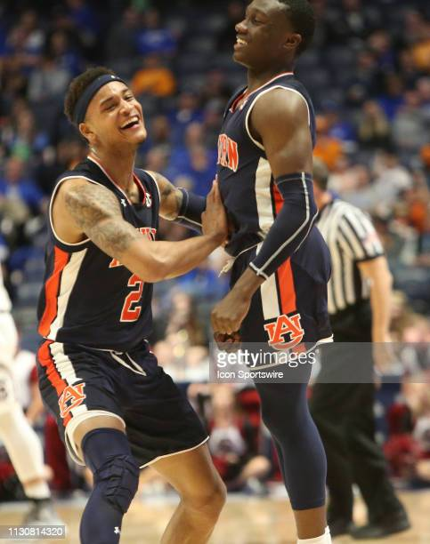 Auburn Tigers guards Bryce Brown and Jared Harper celebrate taking the lead over the South Carolina Gamecocks during a Southeastern Conference...