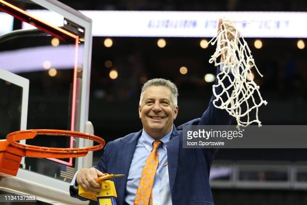 Auburn Tigers head coach Bruce Pearl after cutting down the nets after the NCAA Midwest Regional Final game between the Auburn Tigers and Kentucky...