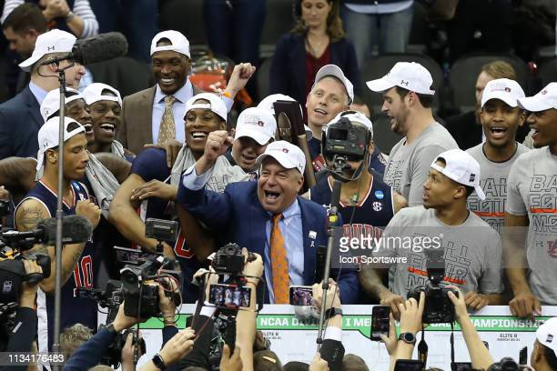 Auburn Tigers head coach Bruce Pearl as all smiles on the platform after defeating the Kentucky Wildcats 7771 in overtime in the NCAA Midwest...