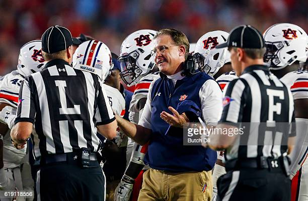 Auburn Tigers head coach Gus Malzahn talks with the referees during the first half of an NCAA college football game against the Mississippi Rebels on...