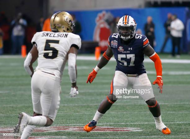 Auburn Tigers linebacker Deshaun Davis watches UCF Golden Knights wide receiver Dredrick Snelson during the ChickfilA Peach Bowl between the UCF...