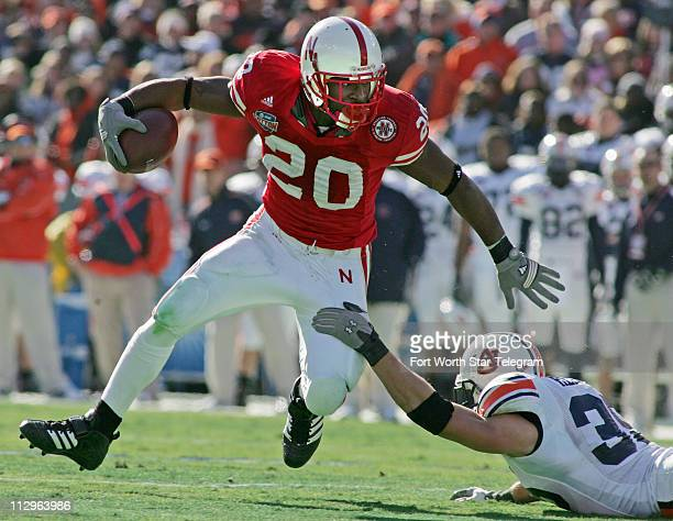 Auburn Tigers linebacker Will Herring gets a hand on Nebraska Cornhuskers running back Marlon Lucky in the first quarter during the Cotton Bowl...