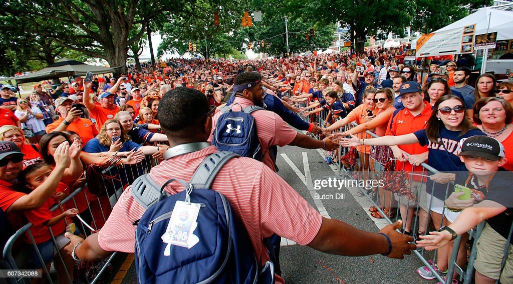 Auburn Tigers players greet fans as they walk through Tiger Walk before an NCAA college football game against Texas A&M Aggies on September 17, 2016 in Auburn, Alabama.