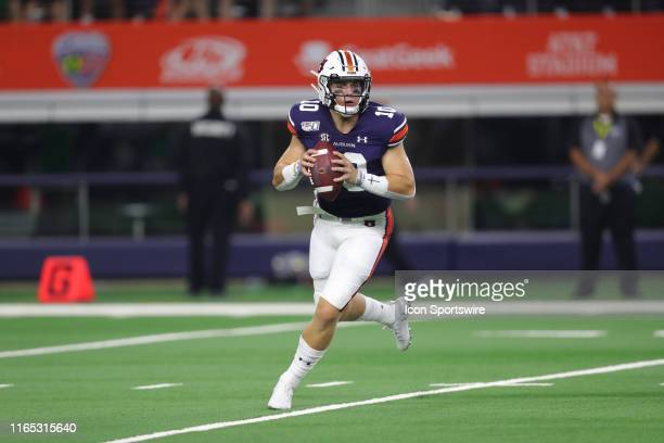 Auburn Tigers quarterback Bo Nix drops back to pass in the AdvoCare Classic between the Auburn Tigers and the Oregon Ducks on August 31 2019 at ATT...