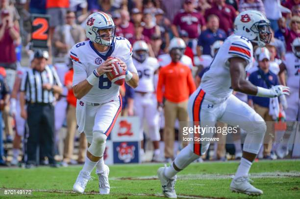 Auburn Tigers quarterback Jarrett Stidham rolls to his right before completing a pass to the flat during the football game between Auburn and Texas...