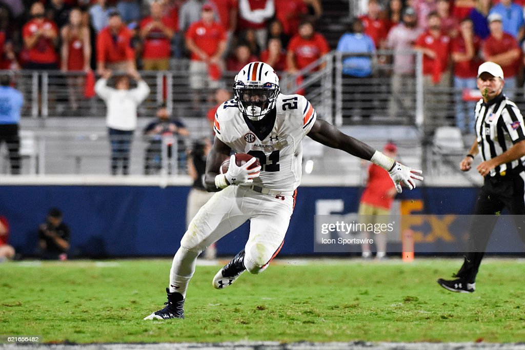 Auburn Tigers running back Kerryon Johnson (21) with a rushing attempt during the football game between Auburn and Ole Miss on October 29, 2016, at Vaught-Hemingway Stadium in Oxford, MS. Auburn would defeat Ole Miss 40-29. (Photo by Andy Altenburger/Icon Sportswire via Getty Images).