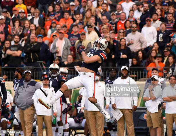 Auburn Tigers tight end Jalen Harris foes up high for a catch during the Music City Bowl game between the Purdue Boilermakers and the Auburn Tigers...