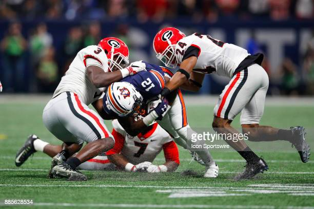 Auburn Tigers wide receiver Eli Stove is tackled by Georgia Bulldogs linebacker Roquan Smith linebacker Lorenzo Carter and safety Dominick Sanders...