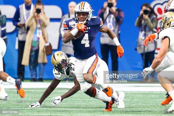Auburn Tigers wide receiver Noah Igbinoghene runs the ball after a catch during the 2017 ChickfilA Peach Bowl football game between The University of...