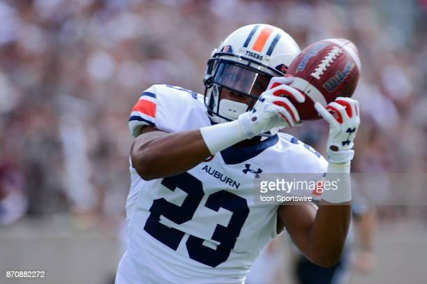 Auburn Tigers wide receiver Ryan Davis catches a pass against his helmet in the flat during the football game between Auburn and Texas AM on November...