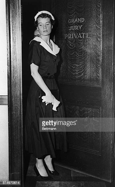 Auburnhaired Susan Hayes West Coast friend of Dr Samuel H Sheppard is shown walking out of the Grand Jury court room here 8/17 after she told of her...