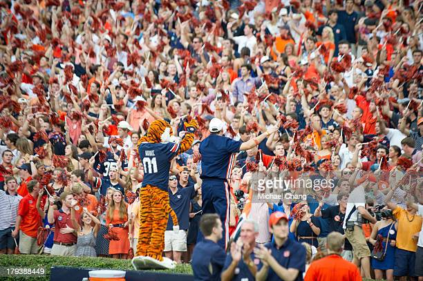 Auburn's mascot Aubie and a cheerleader lead fans in a cheer during their game against the Washington State Cougars on August 31 2013 at JordanHare...