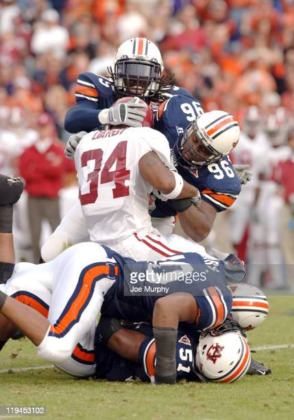 Auburn's Stanley McClover and Wayne Dickens tackle Alabama's Kenneth Darby during first halfat JordanHare Stadium Auburn Alabama Nov 19 2005