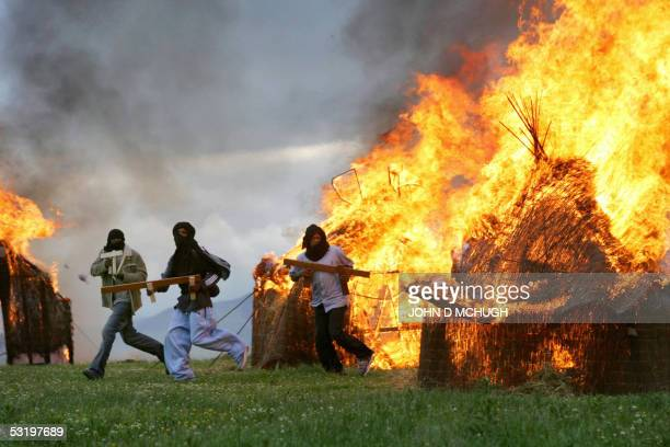 Darfur survivors reenact the destruction of their homes by the Janjaweed militia and Sudanese Army near Gleneagles Scotland 05 July 2005 Thousands of...