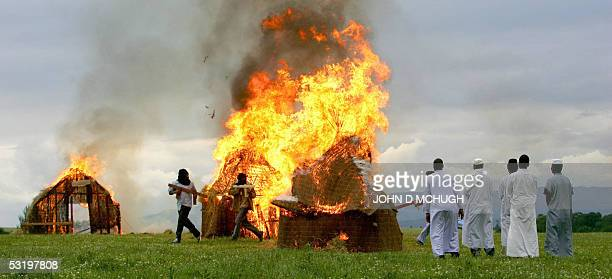 Darfur survivors reenact the destruction of their homes by the Janjaweed milita and Sudanese Army near Gleneagles Scotland 05 July 2005 Thousands of...
