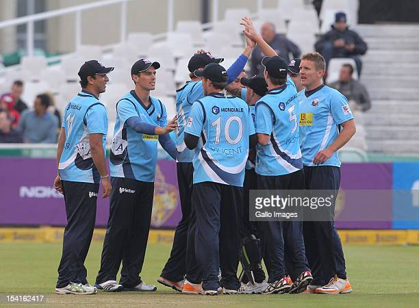 Auckland Aces teammates celebrate during the Karbonn Smart CLT20 match between Kolkata Knight Riders and Auckland Aces at Sahara Park Newlands on...