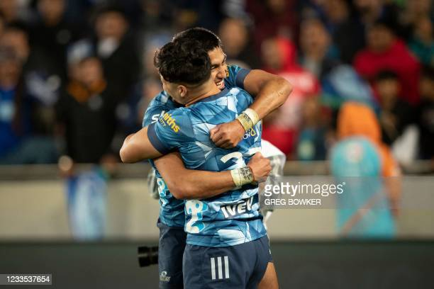 Auckland Blues AJ Lam and Rieko Ioane celebrate the victory in the Super Rugby Trans Tasman final against the Highlanders in Auckland on June 19,...