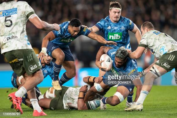 Auckland Blues Akira Ioane avoids a tackle against the Highlanders during the Super Rugby Trans-Tasman final match between the Blues and Highlanders...