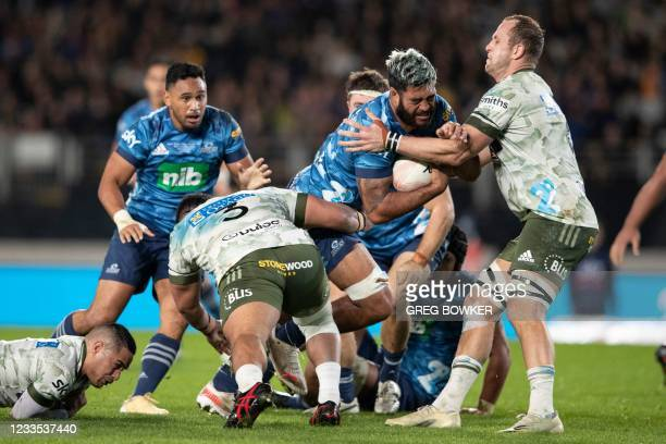 Auckland Blues Akira Ioane avoids a tackle during the Super Rugby Trans-Tasman final match between the Blues and Highlanders in Auckland on June 19,...