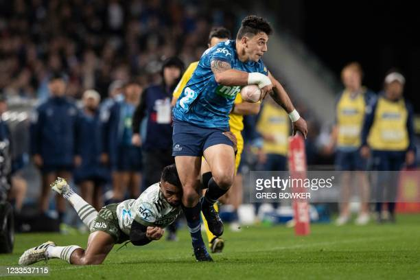 Auckland Blues Bryce Heem runs with the ball against the Highlanders during the Super Rugby Trans-Tasman final match between the Blues and...