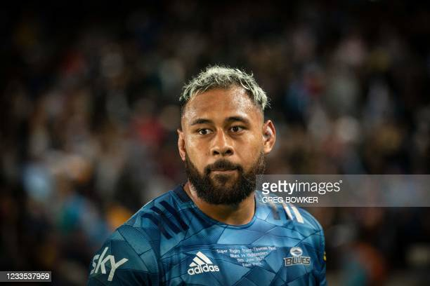 Auckland Blues captain Patrick Tuipulotu looks on as team celebrate the victory against Highlanders after the Super Rugby Trans Tasman final match in...