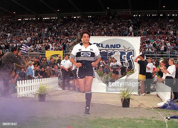 Auckland Blues captain Zinzan Brooke leads his side out onto the field for the inagural Super 12 match between the Wellington Hurricanes and the...