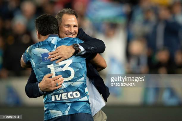 Auckland Blues coach Leon MacDonald with player Rieko Ioane celebrate the victory in the Super Rugby Trans Tasman final against the Highlanders in...