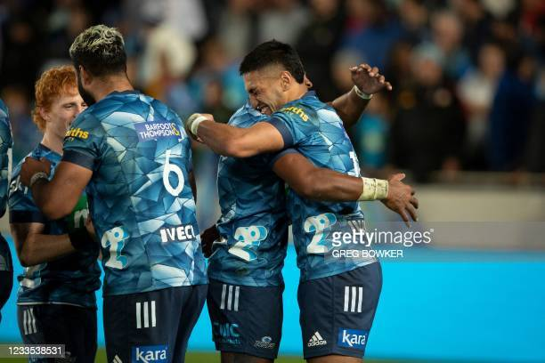 Auckland Blues players celebrate the victory in the Super Rugby Trans Tasman final against the Highlanders in Auckland on June 19, 2021.