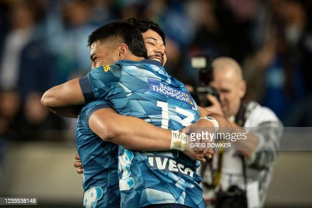 Auckland Blues Rieko Ioane and AJ Lam celebrate the victory in the Super Rugby Trans Tasman final against the Highlanders in Auckland on June 19,...