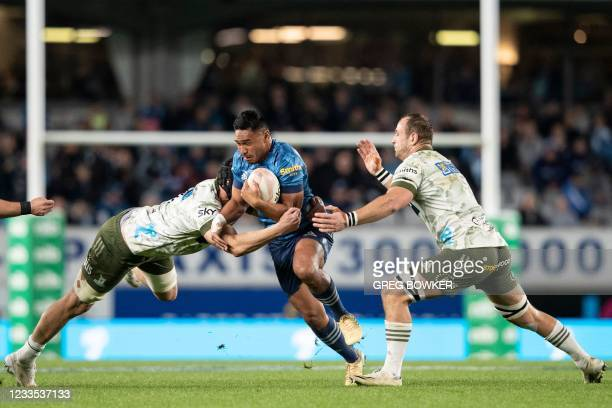 Auckland Blues TJ Faiane avoids a tackle during the Super Rugby Trans-Tasman final match between the Blues and Highlanders in Auckland on June 19,...
