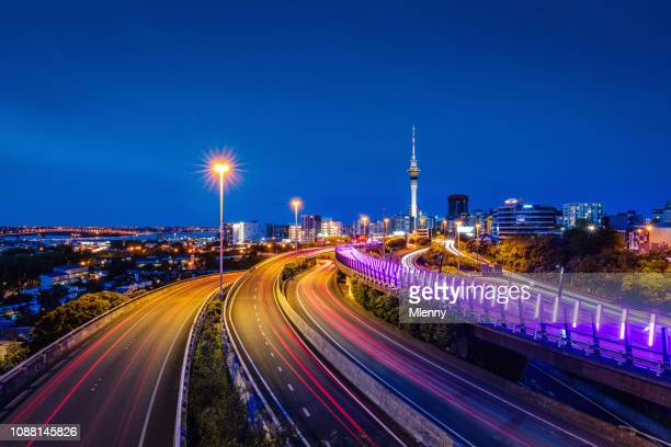 auckland city highway traffic at night new zealand - auckland stock pictures, royalty-free photos & images