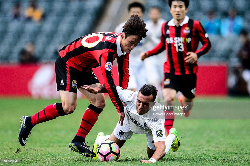 Auckland City Midfielder Clayton Lewis (r) fights for the ball with FC Seoul Midfielder Kim Hangil (l) during the 2017 Lunar New Year Cup match between Auckland City FC (NZL) vs FC Seoul (KOR) on January 28, 2017 in Hong Kong, Hong Kong.