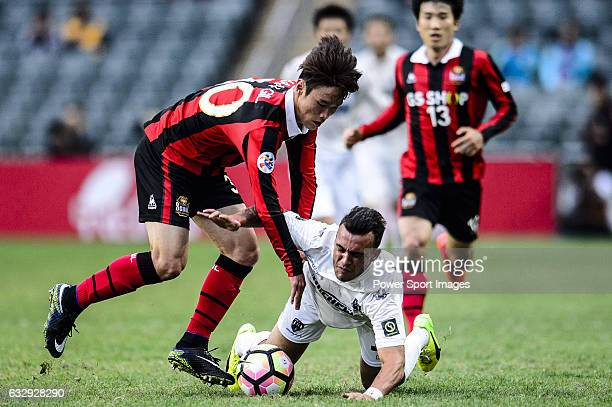 Auckland City Midfielder Clayton Lewis fights for the ball with FC Seoul Midfielder Kim Hangil during the 2017 Lunar New Year Cup match between...