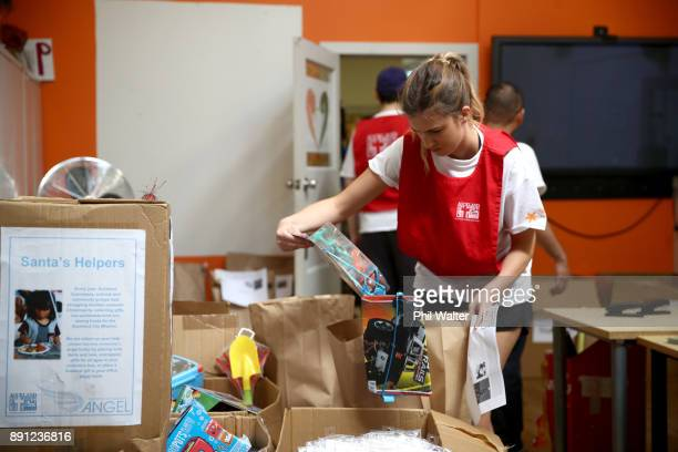 Auckland City Mission volunteer Julia Dempsey packages up presents for families over Christmas on December 13 2017 in Auckland New Zealand Hundreds...