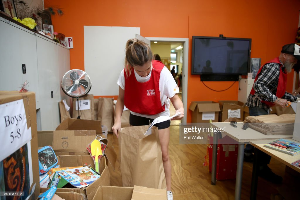 Auckland City Mission volunteer Julia Dempsey packages up presents
