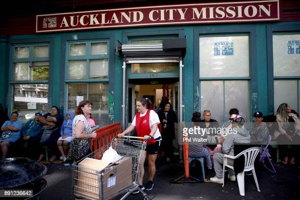 Auckland City Mission volunteers bring out parcels of food and presents for families over Christmas on December 13 2017 in Auckland New Zealand...
