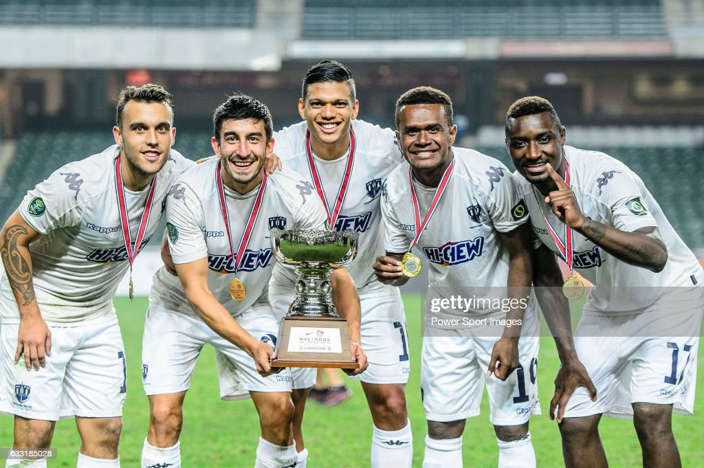 Auckland City players Clayton Lewis, Emiliano Tade, Ryan de Vries, Micah Lea Alafa and Joao Moreira celebrating with the trophy during the 2017 Lunar New Year Cup match between SC Kitchee (HKG) and Auckland City FC (NZL) on January 31, 2017 in Hong Kong, Hong Kong.