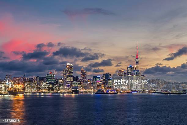 Auckland city with dramatic sunset sky