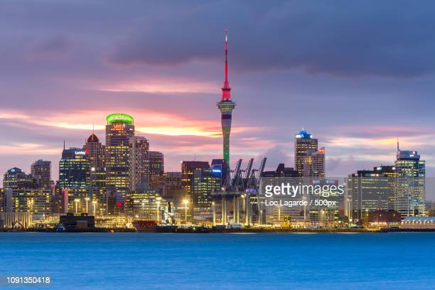 auckland cityscape by night - lagarde stock photos and pictures