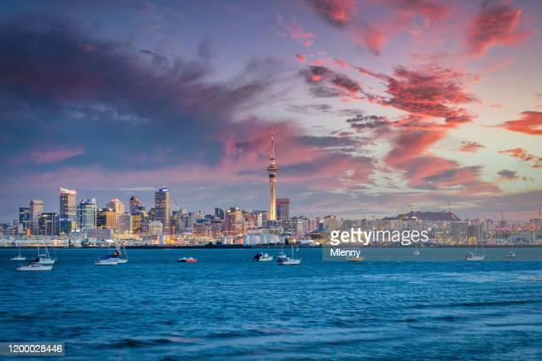 auckland cityscape new zealand colorful sunset twilight - auckland stock pictures, royalty-free photos & images