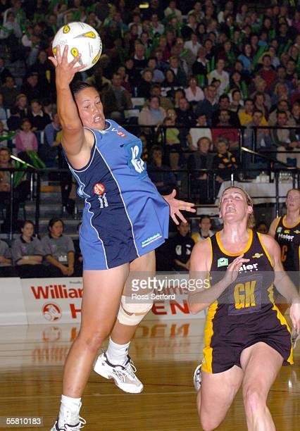 Auckland Diamonds Shelley Norris, left, takes the ball infront of Wellington Shakers Megan Hutton, in the National Bank Netball Cup match at the...