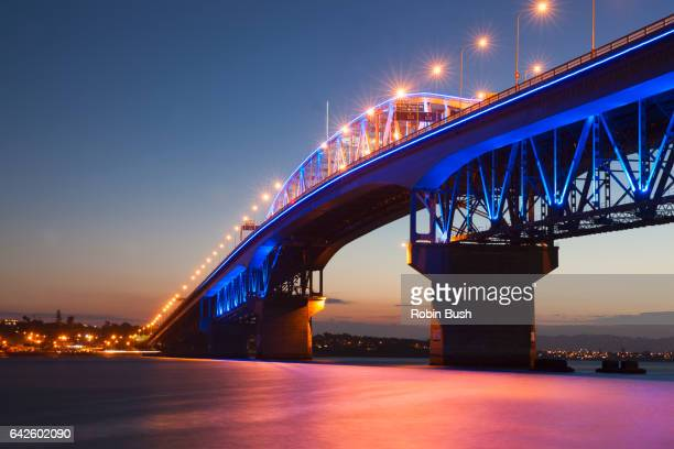 auckland harbour bridge, new zealand - waitemata harbor stock photos and pictures