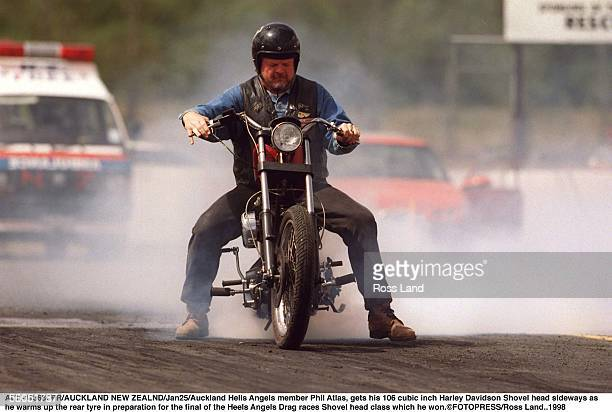 Auckland Hells Angels member Phil Atlas gets his 106 cubic inch Harley Davidson Shovel head sideways as he warms up the rear tyre in preparation for...