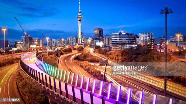 Auckland Lightpath elevated walkaway and urban skyline at dusk with Skytower in middle during evening peak hour