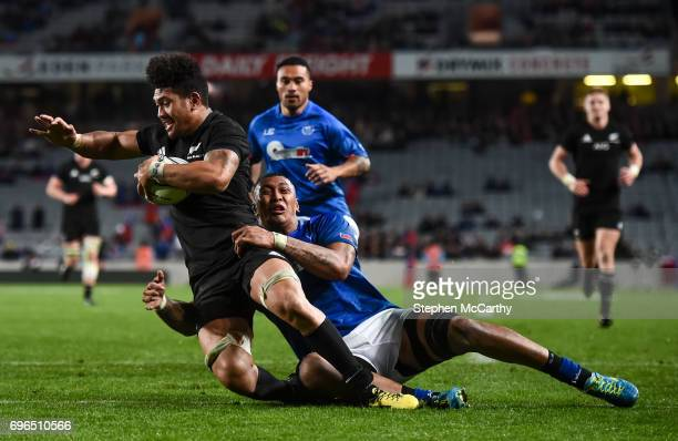 Auckland New Zealand 16 June 2017 Ardie Savea of New Zealand goes over to score his side's eleventh try despite the tackle of Piula Faasalele of...