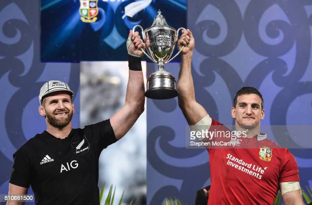 Auckland New Zealand 8 July 2017 New Zealand captain Kieran Read left and British and Irish Lions captain Sam Warburton lift the trophy following the...