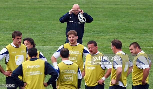 France's head coach Bernard Laporte loocks at his players during a training session at Wilworth campus in Auckland 30 May 2007 France will play...