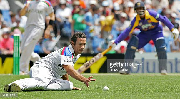 Auckland, NEW ZEALAND: New Zealand's Andre Adams slides in to field a ball as Sri Lanka's Chamar Silva completes a single during the 2nd Twenty20...