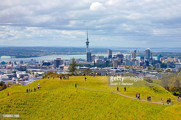 auckland skyline with sky tower from mount eden - auckland stock pictures, royalty-free photos & images