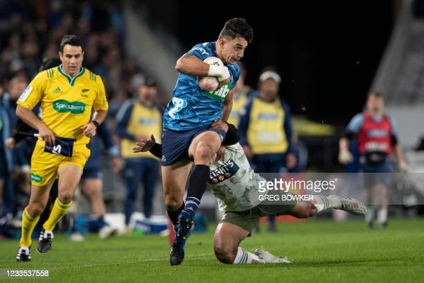 Auckland's Blues Bryce Heem runs with the ball during the Super Rugby Trans-Tasman final match between the Blues and Highlanders in Auckland on June...